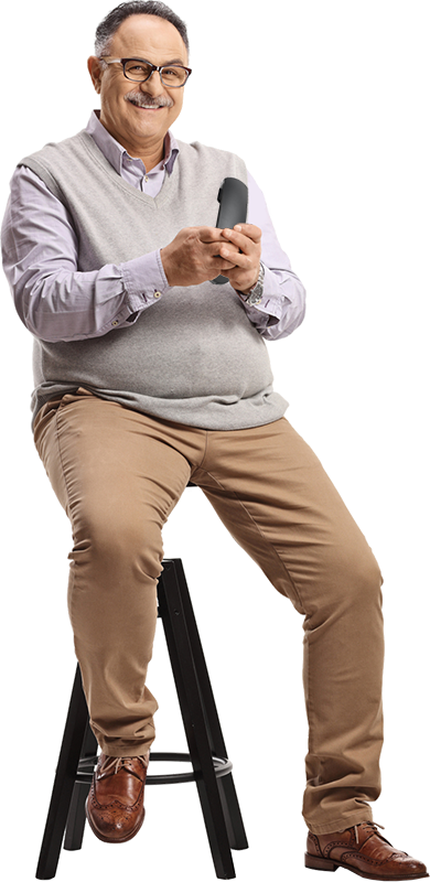 Man sitting on a stool using his phone